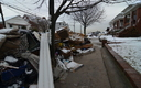 PHOTO: Debris on streets of coastal New York days after Hurricane Sandy. Advocates for the homeless say 17 months later, the housing situation for many is worse than it was last winter. Photo credit: Walt Jennings, FEMA.