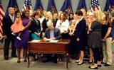 PHOTO: With moms and babies on hand, Gov. Rick Snyder signed the Breastfeeding Anti-Discrimination Act into law on Tuesday, giving Michigan women the right to breastfeed in public. Photo credit: L.  Posthumus