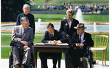 PHOTO: President George H.W. Bush signs the Americans with Disabilities Act into law on July 26, 1990. Photo credit: Wikimedia / Public Domain.