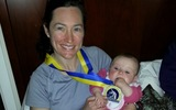PHOTO: Mother Meredith Olsen, an Episcopal Priest from Baltimore, shows the medal she received from running in the Boston Marathon. She is pictured with her niece. Courtesy of Olsen.