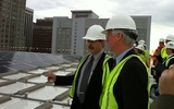 Photo: Amory Lovins of the Rocky Mountain Institute. left, and Raleigh City Councilman Russ Stephenson stand on top of Raleigh's new LEED certified Convention Center. Photo credit: Russ Stephenson