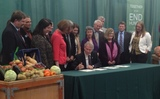 PHOTO: Fresh food and farmers were on hand, along with representatives of the Oregon Food Bank, when Gov. John Kitzhaber signed legislation on Thursday reinstating and increasing the Crop Donation Tax Credit. Photo credit: Kara Walker, Office of Oregon House Republicans.