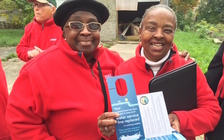 Volunteers wearing red hope to cut some of the red tape for Flint residents to have water pipes replaced. (M. Hornbeck/AARP MI)