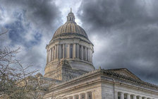 Clouds are gathering over the Washington State Capitol as the clock winds down for lawmakers to come to a budget agreement. (Manuel Iglesias/Flickr)