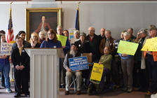 Melissa Hinebauch speaks in Concord on Thursday about her experiences protesting the tax-law changes making their way through Congress. (Granite State Progress)