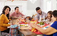Experts advise using compassion if the conversation veers into difficult political topics around this year's holiday dinner table. (Adobe Stock)