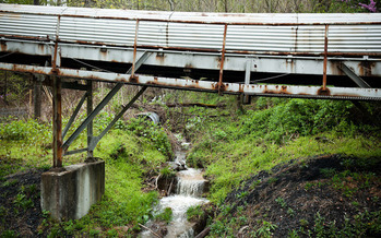 PHOTO: Kentuckians are advocating for clean-water protections as the state updates its discharge regulations on coal operations, such as this coal conveyor outside Portal 31 in Benham. Photo credit: Shawn Poynter/Rural Archive and Kentuckians For The Commonwealth.