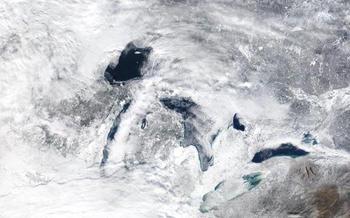 PHOTO: The near total freezeover of the Great Lakes during the brutal winter is impacting summer weather for millions of Wisconsinites because of the much colder water temperature of Lake Michigan. Photo credit: NASA