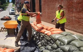 PHOTO: AmeriCorps volunteers helped construct a sandbag wall to protect Clarksville's historic downtown, but they say more needs to be done to find a long-term solution to flooding in this Mississippi River community. Photo credit: Clare Holdinghaus.