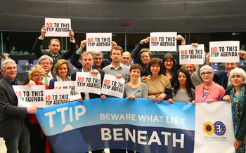 PHOTO: Those opposed to the Transatlantic Trade and Investment Partnership (T-TIP) protested during negotiations in March in Brussels, where the latest round of talks is underway this week. Photo credit: Greens / European Free Alliance / Flickr.