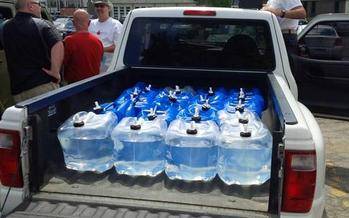 PHOTO: A convoy of trucks from Canada carrying hundreds of gallons of water crossed into Detroit on Thursday in a gesture of support for city residents whose water has been shut off in recent months. Photo credit: M. Barlow.
