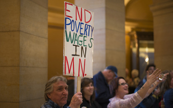 PHOTO: Supporters rallied at the 2014 Legislature for a higher minimum wage, and the first phase of the increase to $9.50 an hour begins Friday, with a bump from $7.25 to $8.00. Photo credit: Fibonacci Blue/Flickr.