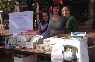 PHOTO: A book giveaway was part of the Eugene event for the Oregon Education Association's Week of Action. This week's message at education forums and fairs statewide is that strong public schools and colleges build strong communities. Photo courtesy Oregon Education Assn.