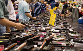 PHOTO: About 40 percent of the gun sales in Washington are private sales, without background checks, between individuals, online or at gun shows like the one in Texas pictured here. Only one of Washington's November ballot measures, I-594, would expand background checks. Photo credit: Glasgows/Wikimedia Commons.