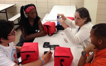 PHOTO: Randallstown High School students recently helped some non-tech-savvy Marylanders learn computer basics at an AARP Maryland event. Photo courtesy of AARP Maryland.