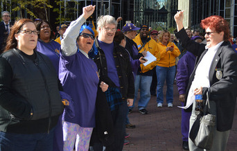 PHOTO: Kim McGowan (right) is among the security guards working for private contractors who say today's security challenges call for more training and better pay. They rallied in Downtown Pittsburgh on Wednesday. Photo credit: Maria Montano.