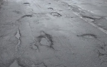 PHOTO: Gov. Rick Snyder's office estimates the poor condition of the state's roads costs Michigan families $500 per year in repairs and lost wages, but local leaders say the cost to business development in the state is even higher. Photo courtesy of www.michigan.gov.