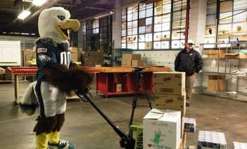 Philadelphia Eagles mascot Swoop delivers healthy food to the Coalition Against Hunger. Credit: Greater Philadelphia Coalition Against Hunger