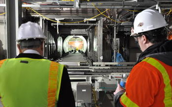 PHOTO: Site Project Manager Jeff Brubaker (right) examines a metal parts treater, part of the huge plant that is expected to begin destroying 523 tons of chemical agents by 2018, stored at the Blue Grass Army Depot. Photo courtesy Blue Grass Chemical Activity.