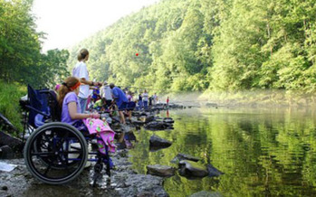 The get outside message for children is being extended to children with disabilities. A professional outdoor educator cites benefits for a child's development, as well as stress relief for the whole family. Credit: USFWS/Southeast via Flickr Creative Commons