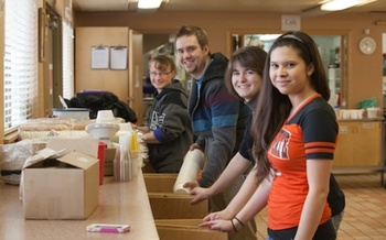 PHOTO: Students from Oregon State University Cascades spent last year's MLK Day helping at the Bend Community Center. This year, the list of Central Oregon projects has grown from 10 to 22. Photo credit: Michelle Bauer.