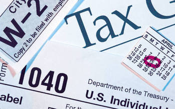 PHOTO: Once again this year, the AARP Foundation's Tax-Aide program is up and running in Wisconsin, offering no-cost tax return preparation. Tax-Aide has served more than 40 million people since it was started 40 years ago. Photo credit: midlibrary.org