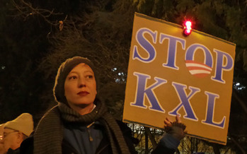 PHOTO: Dozens rallied on the Capitol steps in Wyoming on Tuesday night, asking President Obama to reject the proposed Keystone XL pipeline. Rallies have been taking place around the country. Photo of a protester at an event courtesy of Wikimedia Commons.