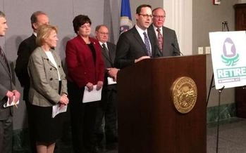 PHOTO: AARP Minnesota State Director Will Phillips (at podium) joined lawmakers to introduce a proposal to eliminate state income taxes on Social Security benefits. Photo credit: Seth Boffeli.