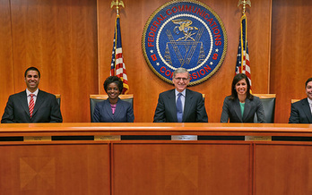 PHOTO: Tom Wheeler (center), chairman of the Federal Communications Commission, is seeking to regulate the Internet as a utility in order to ensure