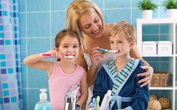 PHOTO: Getting kids to brush their teeth and floss, and reminding parents of how the importance of oral health, are the goals of National Children's Dental Health Month. Photo courtesy of the Centers for Disease Control and Prevention.