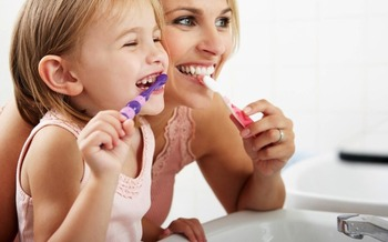 PHOTO: Getting kids to brush their teeth and floss, and reminding parents of the importance of oral health, are the goals of National Children's Dental Health Month. Photo courtesy of the Florida Department of Health.