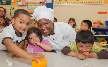 PHOTO: Project Bread�s Chef Vanessa LaBranche with students is part of the outreach that is moving the Commonwealth out of the basement when it comes to participation in school breakfast. Courtesy: Project Bread