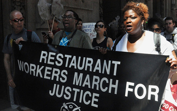 PHOTO: Gov. Cuomo announced this week New York would raise minimum wage by $2.50 for waiters, bartenders and others who work for tips. Groups which lobbied for the change welcome the news, but say their goal is much larger. Photo credit: Michael Fleshman.