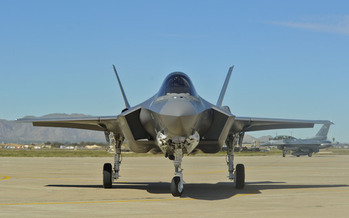 PHOTO: A security expert speaks Wednesday at UNH Durham on how lawmakers are governing under the influence of Pentagon contractors, and says the F-35 fighter is a good example of excessive spending and misplaced priorities. Photo credit: U.S. Air Force.