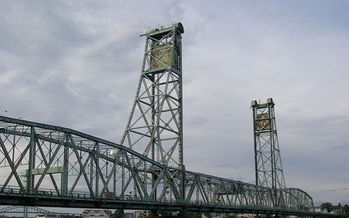 While the Memorial Bridge was taken out of service in 2011, a new report finds more than 360 bridges in Maine in need of repair or upgrade. Credit: JayDuck Wikipedia Commons.