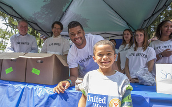 PHOTO: You never know who might show up at a summer meal site! Seattle Seahawks' quarterback Russell Wilson visited with kids last summer to help United Way-sponsored sites reach a summer goal of serving 1 million meals. Photo courtesy United Way of King County.