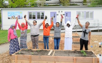 PHOTO: Members of the Green Plate Special club celebrate the addition of raised garden beds to their school's STEM program. Photo credit: Marissa Rousselle.