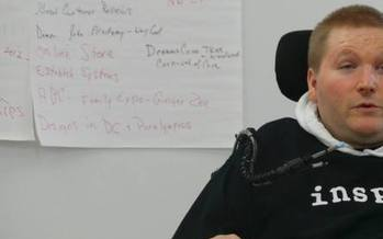 PHOTO: Eric Thomas was paralyzed from the neck down in a shooting, but went on to open his own business, EZ Awareness By Design, thanks to assistance from Goodwill Industries of Mid-Michigan's self-employment services program. Photo courtesy of E. Thomas.