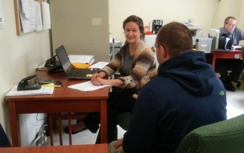 SNAP coordinator Beth Zambia talks with a veteran at the Soldier On shelter in Leeds. At least 26,000 low-income veterans rely on SNAP benefits in the Commonwealth. Courtesy: Food Bank of Western Massachusetts.