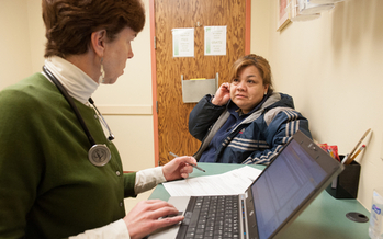 Patient with health provider. Credit: Colorado Community Health Network.
