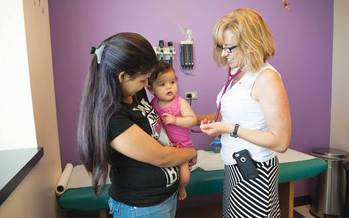 Health provider, mother and child. Credit: Brian Clark, courtesy of Colorado Health Foundation.
