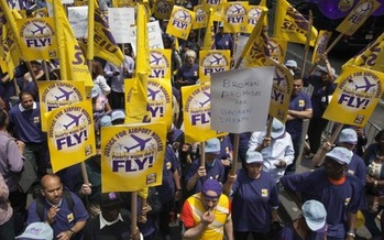 PHOTO: After what they describe as a two-year struggle, baggage handlers and security officers at New York City's airports have won the right to join a union. Photo courtesy of 32BJ SEIU.