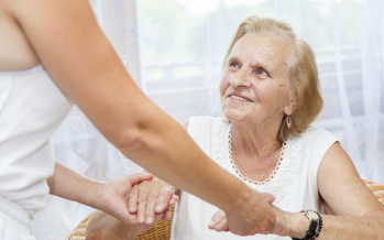 Senior receiving assistance. Credit: iStockphoto.