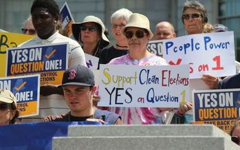 The comment period is under way for the draft language for Question 1. Supporters who gathered in Concord last week say the goal is to hold lawmakers accountable to the people. Credit: Jeff Kirlin
