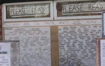 Messages cover the windows of a schizophrenic patient�s house. Credit: Pete S/ Wikimedia Commons.