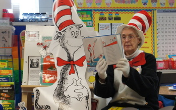 At 101, Kay Roberts still dresses up to read to students from the Cat in the Hat. After a half-century as an educator, she knows what makes a good teacher, and a good student. Courtesy: Massachusetts Teachers Assn.