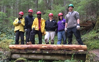 Members of the Pacific Northwest National Scenic Trail Association show off their handiwork, built to go over the Dungeness River in Olympic National Forest. Courtesy: U.S. Forest Service