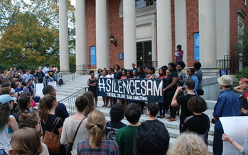 Students and community members gather to protest a statue on the UNC-Chapel Hill campus that recognizes alumni who died fighting for the Confederacy during the Civil War. Credit: Manzoor Cheema
