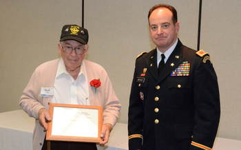 Iowa National Guard Col. Gregory Hapgood, right, presents a plaque to Harold Cline of Marshalltown for participating in this month's Veterans History Project. Credit: Lauren Jensen