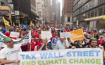 Activists join for a climate change rally in New York City in 2014, that was co-sponsored by National Nurses United, which is organizing a similar event today in Los Angeles. Courtesy: Reza Sunshine/National Nurses United